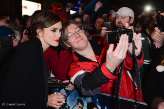 Keira poses for a selfie with a fan